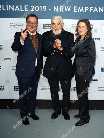 Stock Picture of Mario Adorf (C), Minister President of North Rhine-Westphalia Armin Laschet (L) and CEO of North Rhine-Westphalia Film and Media Foundation Petra Mueller (R) attend the North Rhine-Westphalia Film and Media Foundation Party during the 69th annual Berlin Film Festival, in Berlin, Germany, 10 February 2019. The Berlinale runs from 07 to 17 February.