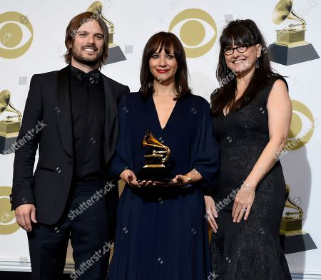 "Rashida Jones, Alan Hicks, Paula DuPre Pesmen. Alan Hicks, from left, Rashida Jones and Paula DuPre Pesmen pose in the press room with the award for best music film for ""Quincy"" at the 61st annual Grammy Awards at the Staples Center, in Los Angeles"