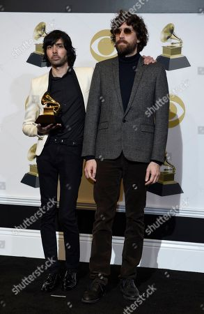 "Xavier de Rosnay, left, and Gaspard Auge, of Justice, pose in the press room with the award for best dance/electronic album for ""Woman Worldwide"" at the 61st annual Grammy Awards at the Staples Center o"