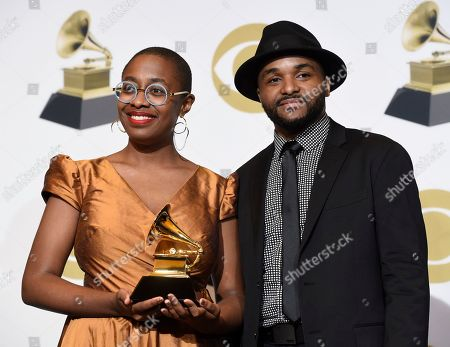 "Cecile McLorin Salvant, Sullivan Fortner. Cecile McLorin Salvant, left, and Sullivan Fortner pose in the press room with the award for best jazz vocal album for ""The Window"" at the 61st annual Grammy Awards at the Staples Center, in Los Angeles"