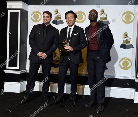 """Jason Cole, Hiro Murai, Ibra Ake. Jason Cole, from left, Hiro Murai and Ibra Ake pose in the press room with the award for best music video for Childish Gambino's """"This Is America"""" at the 61st annual Grammy Awards at the Staples Center, in Los Angeles"""