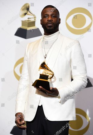 """Jay Rock poses in the press room with the award for best rap performance for """"King's Dead"""" at the 61st annual Grammy Awards at the Staples Center, in Los Angeles"""