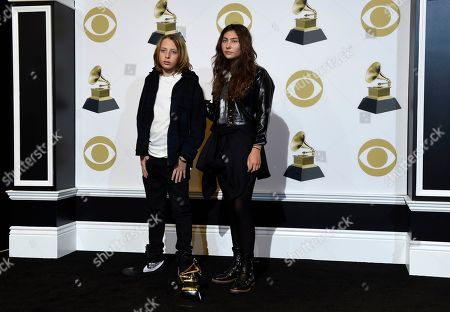 """Christopher Nicholas Cornell, Toni Cornell. Christopher Nicholas Cornell, left, and Toni Cornell pose in the press room with the award for best rock performance for """"When Bad Does Good"""" on behalf of their late father Chris Cornell at the 61st annual Grammy Awards at the Staples Center, in Los Angeles"""
