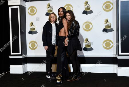"""Christopher Nicholas Cornell, Vicky Karayiannis, Toni Cornell. Christopher Nicholas Cornell, from left, Vicky Karayiannis and Toni Cornell pose in the press room on behalf of the late Chris Cornell, winner of the award for best rock performance for """"When Bad Does Good"""" at the 61st annual Grammy Awards at the Staples Center, in Los Angeles"""