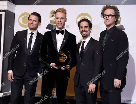 """Benj Pasek, Justin Paul, Alex Lacamoire, Greg Wells. Benj Pasek, from left, Justin Paul, Alex Lacamoire and Greg Wells pose in the press room with the award for best compilation soundtrack for visual media for """"The Greatest Showman"""" at the 61st annual Grammy Awards at the Staples Center, in Los Angeles"""