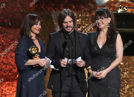 "Rashida Jones, Alan Hicks, Paula DuPre Pesmen. Rashida Jones, from left, Alan Hicks and Paula DuPre Pesmen accept the award on behalf of Quincy Jones for best music film for ""Quincy"" at the 61st annual Grammy Awards, in Los Angeles"