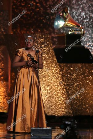 "Cecile McLorin Salvant accepts the award for best jazz vocal album for ""The Window"" at the 61st annual Grammy Awards, in Los Angeles"