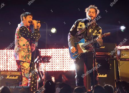 Anthony Kiedis, Post Malone. Anthony Kiedis, left, of Red Hot Chili Peppers, and Post Malone perform a medley at the 61st annual Grammy Awards, in Los Angeles
