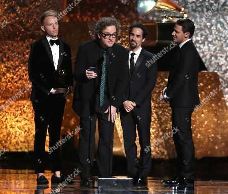 """Justin Paul, Greg Wells, Alex Lacamoire, Benj Pasek. Justin Paul, from left, Greg Wells, Alex Lacamoire and Benj Pasek accept the award for best compilation soundtrack for visual media for """"The Greatest Showman"""" at the 61st annual Grammy Awards, in Los Angeles"""
