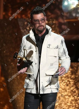 """Jason Crabb accepts the award for best roots gospel album for """"Unexpected"""" at the 61st annual Grammy Awards, in Los Angeles"""