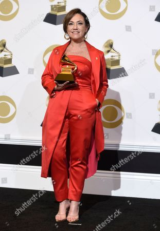 "Claudia Brant poses in the press room with the award for best Latin pop album for ""Sincera"" at the 61st annual Grammy Awards at the Staples Center, in Los Angeles"