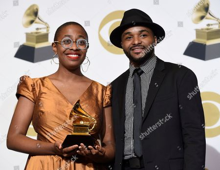 "Stock Photo of Cecile McLorin Salvant, Sullivan Fortner. Cecile McLorin Salvant, left, and Sullivan Fortner pose in the press room with the award for best jazz vocal album for ""The Window"" at the 61st annual Grammy Awards at the Staples Center, in Los Angeles"