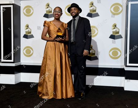"Stock Image of Cecile McLorin Salvant, Sullivan Fortner. Cecile McLorin Salvant, left, and Sullivan Fortner pose in the press room with the award for best jazz vocal album for ""The Window"" at the 61st annual Grammy Awards at the Staples Center, in Los Angeles"