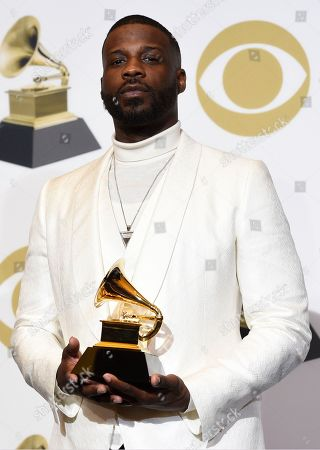 """Stock Picture of Jay Rock poses in the press room with the award for best rap performance for """"King's Dead"""" at the 61st annual Grammy Awards at the Staples Center, in Los Angeles"""