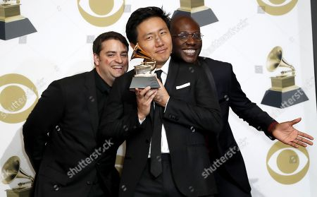 Stock Photo of Jason Cole (L), Hiro Murai (C), and Ibra Ake (R) pose in the press room with the Grammy for Best Music Video during the 61st annual Grammy Awards ceremony at the Staples Center in Los Angeles, California, USA, 10 February 2019.