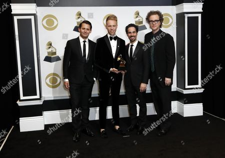 Stock Picture of Benj Pasek, Paul Pasek, Alex Lacamoire and Greg Wells pose in the press room with the Grammy for Best Compilation Soundtrack for Visual Media during the 61st annual Grammy Awards ceremony at the Staples Center in Los Angeles, California, USA, 10 February 2019.