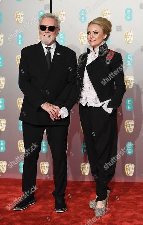 British musician and Queen drummer Roger Taylor and his wife Sarina Potgieter attend the 72nd annual British Academy Film Awards at the Royal Albert Hall in London, Britain, 10 February 2019. The ceremony is hosted by the British Academy of Film and Television Arts (BAFTA).