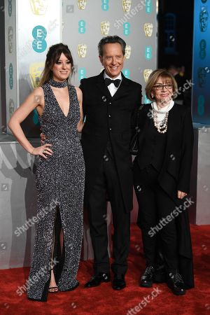 Richard E. Grant (C) and wife Joan Washington (R) attend the 72nd annual British Academy Film Awards at the Royal Albert Hall in London, Britain, 10 February 2019. The ceremony is hosted by the British Academy of Film and Television Arts (BAFTA).
