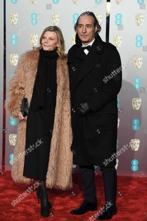 Alexandre Desplat (R) and his wife violinist Dominique Lemonnier (L) attend the 72nd annual British Academy Film Awards at the Royal Albert Hall in London, Britain, 10 February 2019. The ceremony is hosted by the British Academy of Film and Television Arts (BAFTA).