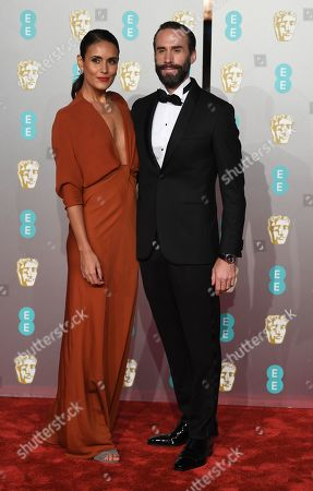 Joseph Fiennes (R) and Italian actress Maria Dolores Dieguez (L) attend the 72nd annual British Academy Film Awards at the Royal Albert Hall in London, Britain, 10 February 2019. The ceremony is hosted by the British Academy of Film and Television Arts (BAFTA).
