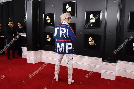 Ricky Rebel arrives at the 61st annual Grammy Awards at the Staples Center wearing a jacket with the word Trump on it,, in Los Angeles