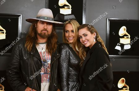 Billy Ray Cyrus, Tish Cyrus, Miley Cyrus. Billy Ray Cyrus, from left, Tish Cyrus, and Miley Cyrus arrive at the 61st annual Grammy Awards at the Staples Center, in Los Angeles