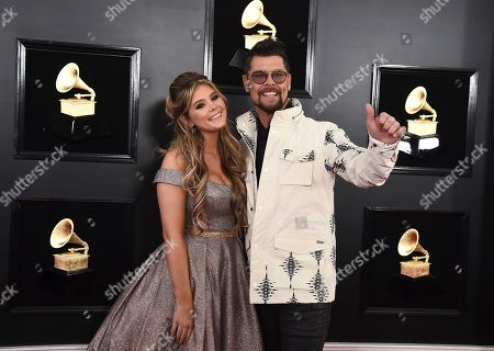 Ashleigh Taylor, Jason Crabb. Ashleigh Taylor, left, and Jason Crabb arrive at the 61st annual Grammy Awards at the Staples Center, in Los Angeles