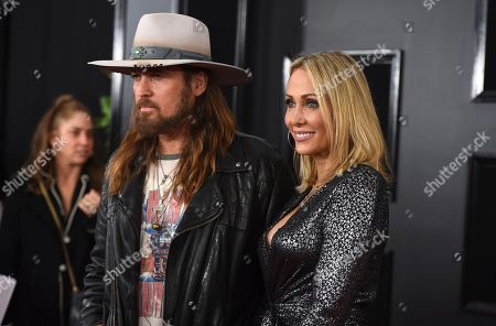Billy Ray Cyrus, Tish Cyrus. Billy Ray Cyrus, left, and Tish Cyrus arrive at the 61st annual Grammy Awards at the Staples Center, in Los Angeles
