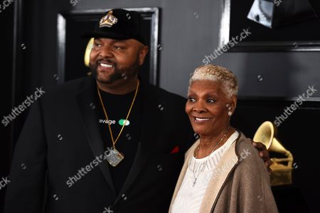 Damon Elliott, Dionne Warwick. Damon Elliott, left, and Dionne Warwick arrive at the 61st annual Grammy Awards at the Staples Center, in Los Angeles
