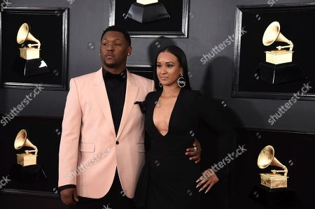 Stock Image of Hit Boy, left, and guest arrive at the 61st annual Grammy Awards at the Staples Center, in Los Angeles