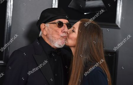 Stock Picture of Lou Adler, Page Hannah. Lou Adler, left, and Page Hannah arrive at the 61st annual Grammy Awards at the Staples Center, in Los Angeles