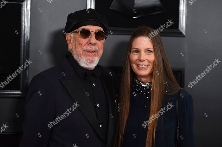 Stock Photo of Lou Adler, Page Hannah. Lou Adler, left, and Page Hannah arrive at the 61st annual Grammy Awards at the Staples Center, in Los Angeles
