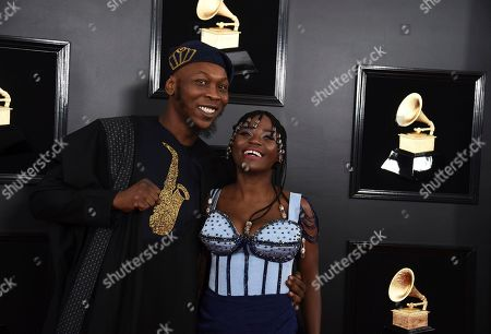 Seun Kuti, Yetunde George Ademiluyi. Seun Kuti, left, and Yetunde George Ademiluyi arrive at the 61st annual Grammy Awards at the Staples Center, in Los Angeles