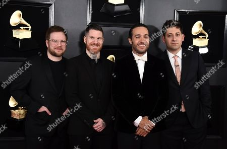 Stock Photo of Patrick Stump, Andy Hurley, Pete Wentz, Joe Trohman. Patrick Stump, from left, Andy Hurley, Pete Wentz, and Joe Trohman of Fall Out Boy arrive at the 61st annual Grammy Awards at the Staples Center, in Los Angeles