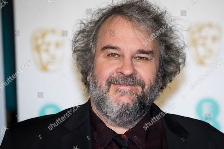 Peter Jackson poses for photographers upon arrival at the BAFTA Film Awards in London