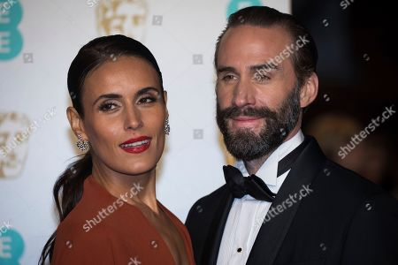 Maria Dolores Dieguez, Joseph Fiennes. Maria Dolores Dieguez and Joseph Fiennes pose for photographers upon arrival at the BAFTA Film Awards in London