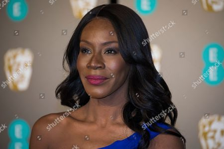 Stock Picture of Amma Asante poses for photographers upon arrival at the BAFTA Film Awards in London