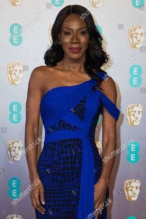 Amma Asante poses for photographers upon arrival at the BAFTA Film Awards in London