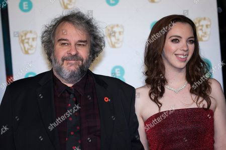 Peter Jackson, Katie Jackson. Peter Jackson and Katie Jackson pose for photographers upon arrival at the BAFTA Film Awards in London