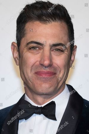 Stock Photo of Josh Singer poses for photographers upon arrival at the BAFTA Film Awards in London
