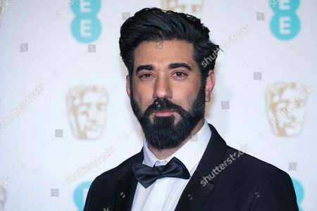 Ray Panthaki poses for photographers upon arrival at the BAFTA Film Awards in London