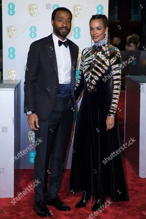 Chiwetel Ejiofor, Frances Aaternir. Chiwetel Ejiofor and Frances Aaternir pose for photographers upon arrival at the BAFTA Film Awards in London
