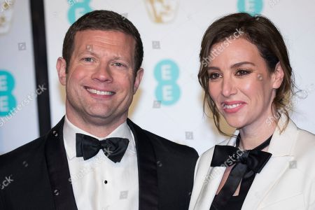 Dermot O'Leary, Dee Koppang. Dermot O'Leary and Dee Koppang pose for photographers upon arrival at the BAFTA Film Awards in London