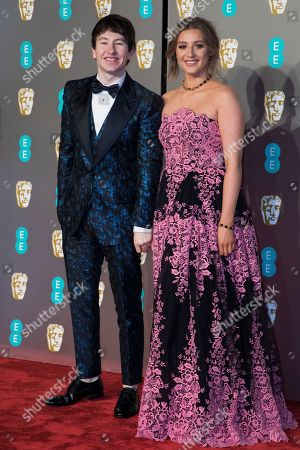 Barry Keoghan, Shona Guerin. Barry Keoghan and Shona Guerin pose for photographers upon arrival at the BAFTA Film Awards in London