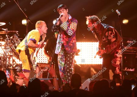 Flea, Anthony Kiedis, Post Malone. Flea, from left, and Anthony Kiedis, of Red Hot Chili Peppers, and Post Malone perform a medley at the 61st annual Grammy Awards, in Los Angeles
