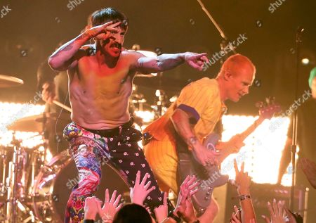 Anthony Kiedis, Flea. Anthony Kiedis, left, and Flea, of Red Hot Chili Peppers, perform a medley at the 61st annual Grammy Awards, in Los Angeles