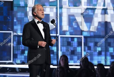President and CEO of the Recording Academy Neil Portnow introduces an In Memoriam tribute at the 61st annual Grammy Awards, in Los Angeles