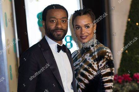 Chiwetel Ejiofor, Frances Aaternir. Chiwetel Ejiofor and Frances Aaternir pose for photographers upon arrival at the BAFTA Film Awards after party in London