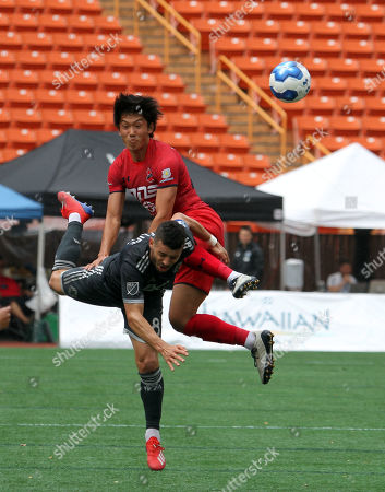 Iwaki FC midfielder Kim Deseng #15 knocks over Vancouver Whitecaps midfielder Felipe Martins #8 during the Pacific Rim Cup 3rd place match between Vancouver Whitecaps FC and IwakiFC at Aloha Stadium in Honolulu , HI - Michael Sullivan/CSM