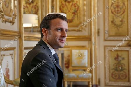 Stock Image of President Emmanuel Macron meets with Patrick Kanner. French President Emmanuel Macron meets with President of the Union centrist group at the French Senate Herve Marseille at the Elysee Palace in Paris, Friday Feb.8 2019. French President Macron is meeting with politicians to discuss his plans to hold a referendum aimed at appeasing the so-called Yellow Vests protestors